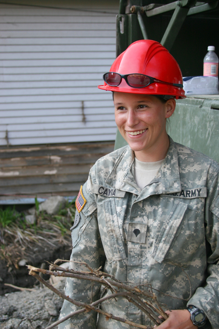 Flooding ^ Hurricane/Tropical Storm ^ Mudslide/Landslide ^ Severe Storm - Pittsfield, Vt. , September 12, 2011 -- Despite the enormous amount of clean up required due to flooding from tropical storm Irene, this National Guard member smiles while helping Vermonters clean up the mess. Photo by Angela Drexel