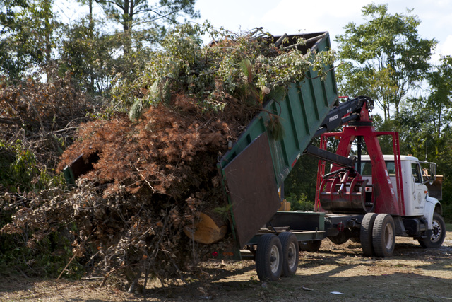Hurricane/Tropical Storm - Roanoke Rapids, N. C. , September 12, 2011 -- A city truck dumps another load of wood debris collected after hundreds of trees were toppled in Roanoke Rapids. FEMA funding can help counties and cities with funding of debris removal.  FEMA photo/ Tim Burkitt