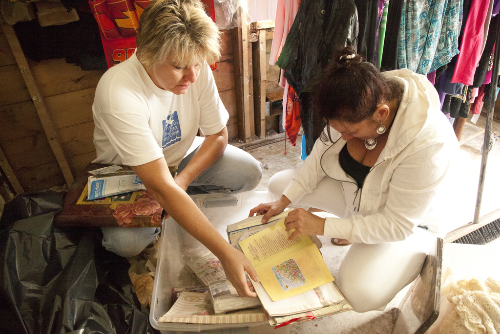 Flooding ^ Hurricane/Tropical Storm - Manville, N. J. , September 17, 2011 -- Cindy Zimmerman, a Faith Lutheran Church volunteer, and disaster survivor Dawn Cohen, check water-damaged photos in her recently flooded home. Volunteers from Faith Lutheran Church in Hillsborough, New Jersey, remove debris from the home of disaster survivors Dawn and David Cohen whose home in Manville suffered severe flooding damage caused by Hurricane Irene on August 28. FEMA works with and coordinates the generous activities of volunteer agencies like Lutheran Disaster Response when responding to disasters. Photo by Christopher Mardorf /  FEMA.