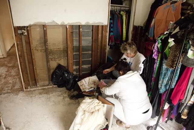 Flooding ^ Hurricane/Tropical Storm - Manville, N. J. , September 17, 2011 -- Dawn Cohen (left), a disaster survivor, and Cindy Zimmermann (right), a volunteer from Faith Lutheran Church in Hillsborough, sort through water-damaged clothing in a stripped bedroom in the home of disaster survivors Dawn and David Cohen whose house in Manville suffered severe flooding damage caused by Hurricane Irene on August 28. FEMA works with and coordinates the generous activities of volunteer agencies like Lutheran Disaster Response when responding to disasters. Photo by Christopher Mardorf /  FEMA.