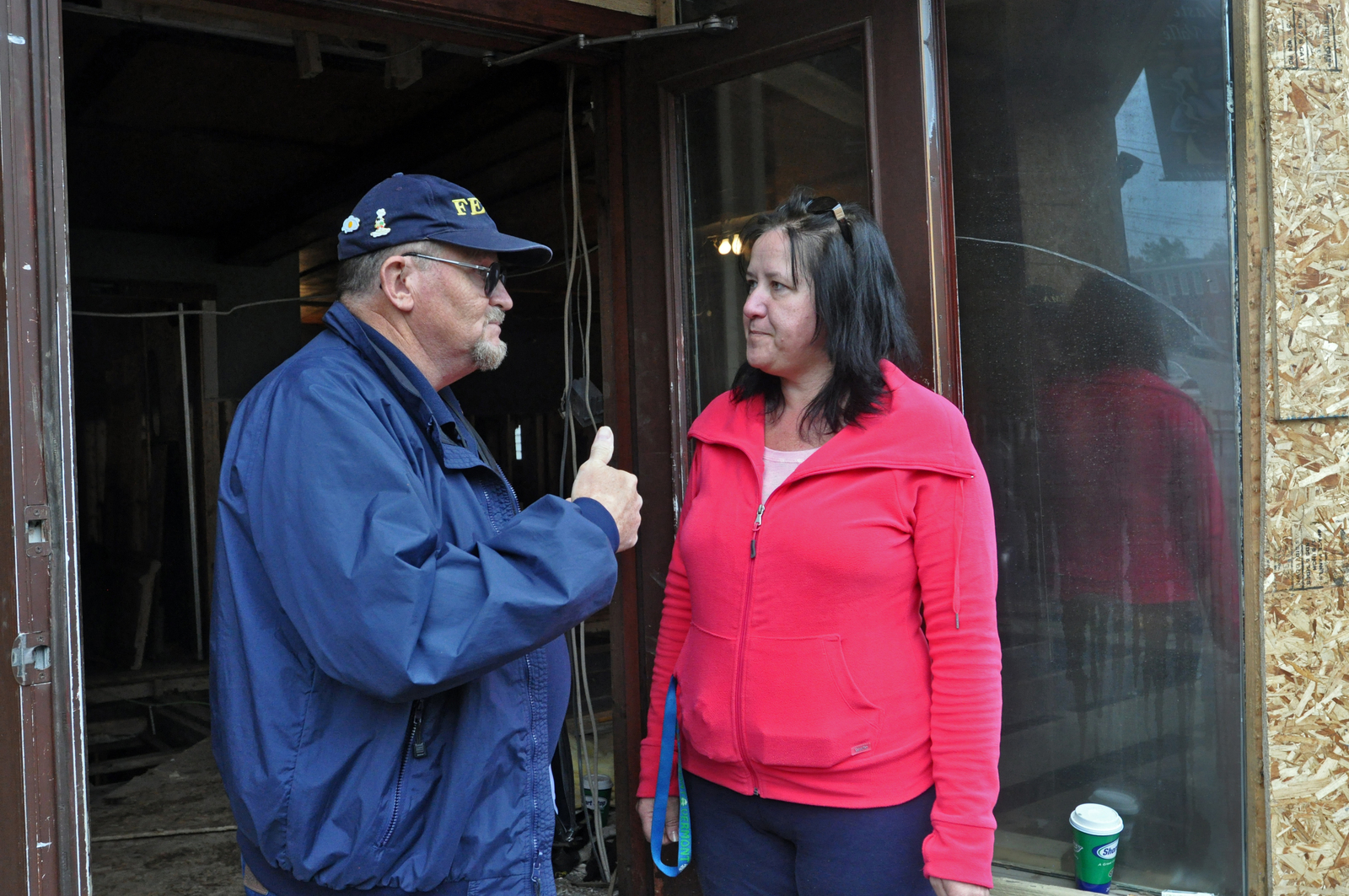 Flooding ^ Hurricane/Tropical Storm ^ Severe Storm - Wilmington, Vt. , September 20, 2011 -- FEMA's Danny Baker talks with Maple Leaf Malt Brewery Company owner, Margaret Ziolkowski, about the damage tropical storm Irene caused to her business. Ms. Ziolkowski, like other Wilmington businesses, are working hard to be open for fall foliage visitors. The town and businesses of Wilmington were badly damaged by flooding in the downtown area. Photo by Wendell A. Davis Jr.