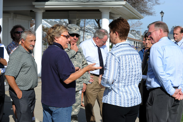 Hurricane/Tropical Storm - East Haven, Conn. , September 26, 2011 --FEMA Public Information Specialist, Sally Mackert, second from left, speaks to Mayor April Capone, striped shirt, during a visit with other elected officials and Army Corps of Engineer Representatives who were touring areas impacted by Tropical Storm Irene.  Jocelyn Augustino/FEMA
