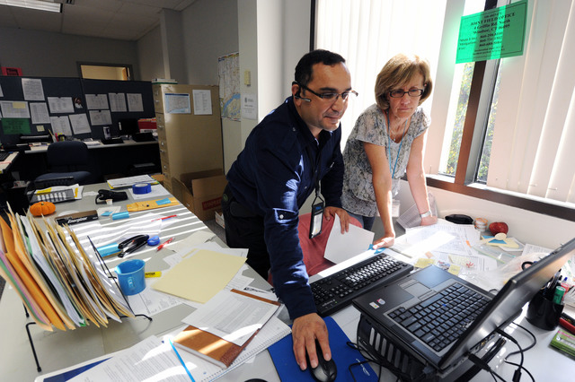 Hurricane/Tropical Storm - Windsor, Conn. , September 27, 2011 --FEMA Joint Field Office IT Network Manager, left, helps FEMA JFO, Mitigation Branch Director, Cheryl Ramsey with her computer in the Joint Field Office.  Jocelyn Augustino/FEMA