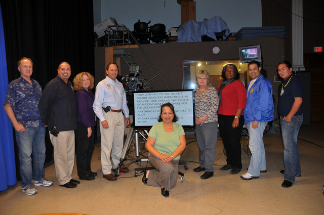 Flooding ^ Hurricane/Tropical Storm ^ Severe Storm - Greenfield, Mass. , September 30, 2011 -- The production crew and Federal Coordinating Officer take a group photo following taping of a 25 minute program featuring interviews with the Federal Coordinating Officer, FEMA Mitigation, HSUS, IRS and NFIP at the Greenfield Community Television (GCTV) studios. (Left to right) Jack Brennan, RX DAE; Alberto Pillot, RII DAE; Pauli Nugent, RI DAE; FCO Mark H. Landry; (kneeling) Maria Padron, HQ DAE; Marilyn Johnson, SBA PIO; Debra Young, RI DAE; Jose Vejarano, SBA PIO and Rian Carlson, HQ DAE. Photo by Win Henderson/FEMA