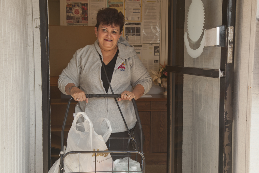 Flooding ^ Hurricane/Tropical Storm - Bound Brook, N. J. , October 5, 2011 -- Hurricane Irene disaster survivor Virgen Feliciano receives clothing and essential supplies at the Salvation Army Bound Brook Temple in Bound Brook, New Jersey. FEMA partners with numerous volunteer agencies like the Salvation Army to provide needed assistance to to disaster survivors. Photo by Christopher Mardorf /  FEMA.