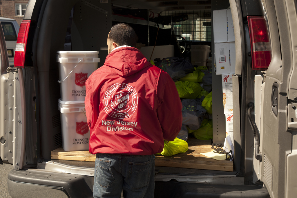 Flooding ^ Hurricane/Tropical Storm - Bound Brook, N. J. , October 5, 2011 -- Salvation Army driver Jaamal Montesino unpacks a Salvation Army delivery truck filled with essential supplies for survivors of Hurricane Irene at the Salvation Army Bound Brook Temple in Bound Brook, New Jersey. FEMA partners with numerous volunteer agencies like the Salvation Army to provide needed assistance to to disaster survivors. Photo by Christopher Mardorf /  FEMA.