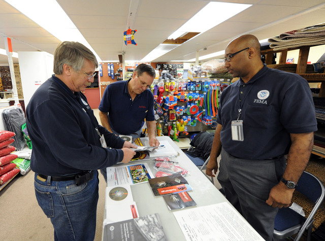 Hurricane/Tropical Storm - Madison, Conn. , October 6, 2011 -- FEMA Community Education Specialist Steve Klein, left, and Warren Kurten, right, speak with Charlie Hosmer, during an event held at Tuxis Lumber.  Mitigation events are being held in various locations throughout the state to inform residents of ways to prepare and mitigate for and after a disaster.  Jocelyn Augustino/FEMA