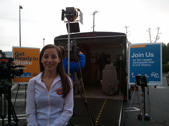 Earthquake - Northridge, Calif. , Oct. 20, 2011 -- FEMA Region IX Earthquake Specialist, Jennifer Lynette, in front of an earthquake simulator truck at the Great California ShakeOut media event at Target. The ShakeOut drill and press event participants included FEMA, CalEMA, LA City Council Members, USGS, SCEC, ECA, Mexican delegation, Japanese delegation, Target, and the general public.