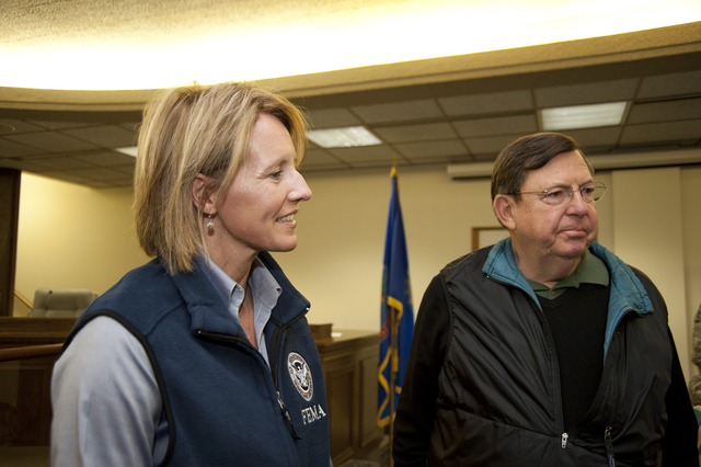Flooding - Minot, N. D. , Oct. 20, 2011 -- FEMA Associate Administrator of Response and Recovery William Carwile and Federal Coordinating Officer Deanne Criswell met with state and local officials at Minot's City Hall. FEMA is working with state and local partners to provide assistance to those affected by June's historic Souris River flood in Minot. FEMA photo by Cynthia Hunter