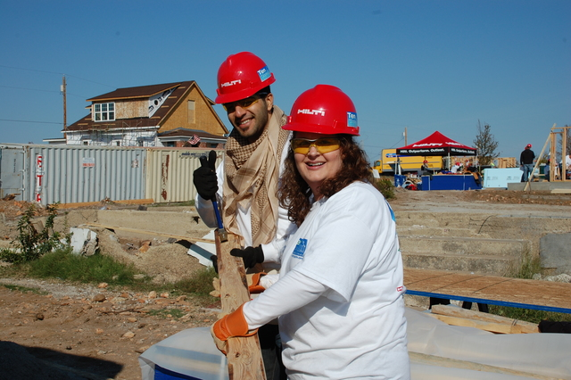 Tornado - Joplin, Mo. , October 29, 2011 -- Yahya Amiri and Tammy Whillhoit work together to help build ten homes in Joplin. Amiri is from United Arab Emirites and Willhoit is from Tulsa, Oklahoma. Both are working together with Habitat for Humanity and other volunteer organizations to build ten homes in ten days for those impacted by the May 22, 2011 tornado. Photo by Jace Anderson/FEMA
