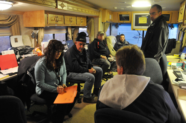 Severe Storm ^ Winter Storm - East Hartford, Conn. , Nov. 5, 2011 -- Bryan Toman (seated right), manager of the Rentschler Field ISB in Connecticut, holds an early morning planning meeting with FEMA staff before the planned arrival of commodities. FEMA is assisting the survivors of Winter Storm Alfred and is providing water, ready-to-eat meals, cots, blankets and generators in the aftermath of the unusual late October storm. Photo by Norman Lenburg/FEMA