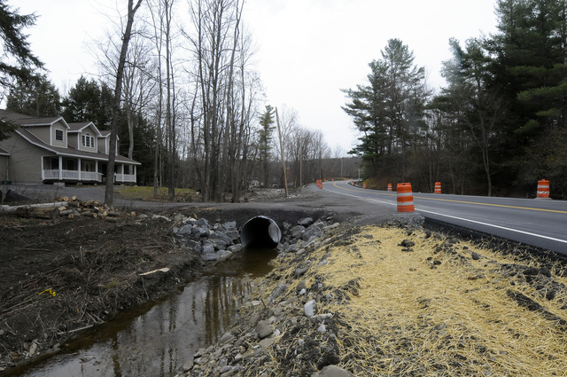 Flooding ^ Hurricane/Tropical Storm - West Berne, N. Y. , Nov. 17, 2011 -- Repaired roadway and culverts along County Route 443 that were destroyed by flooding from Hurricane Irene. FEMA plays a vital role supporting State, Tribal and local governments as they respond to the impacts of Hurricane Irene. Hans Pennink/FEMA