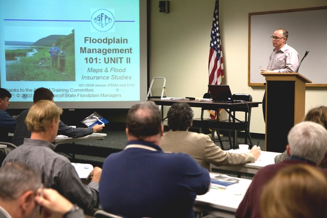 Flooding ^ Hurricane/Tropical Storm - Old Lyme, Conn. , Nov. 29, 2011 -- David Knowles, a professional engineer in the Federal Emergency Management Agency's Region I Office of Risk Analysis Branch of the Mitigation Division, leads a class for more than 60 local officials during a National Flood Insurance Program Workshop in Old Lyme. Connecticut was declared a disaster on September 2, 2011 in the aftermath of Tropical Storm Irene that resulted in major river flooding. Photo by Ed Edahl/FEMA