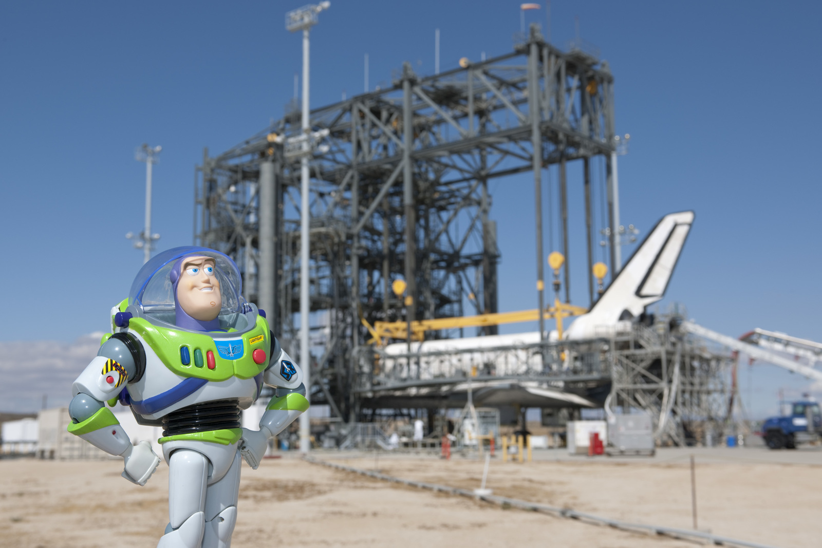Discovery's STS-128 mission returns after a mission to the International Space Station. A Disney figure of Buzz Lightyear, space ranger that accompanied the mission after spending 15 months aboard the Station, is shown standing in front of the Shuttle. While on the station, Buzz supported NASA's education outreach program – STEM (Science, Technology, Engineering and Mathematics) by creating a series of fun educational online outreach programs