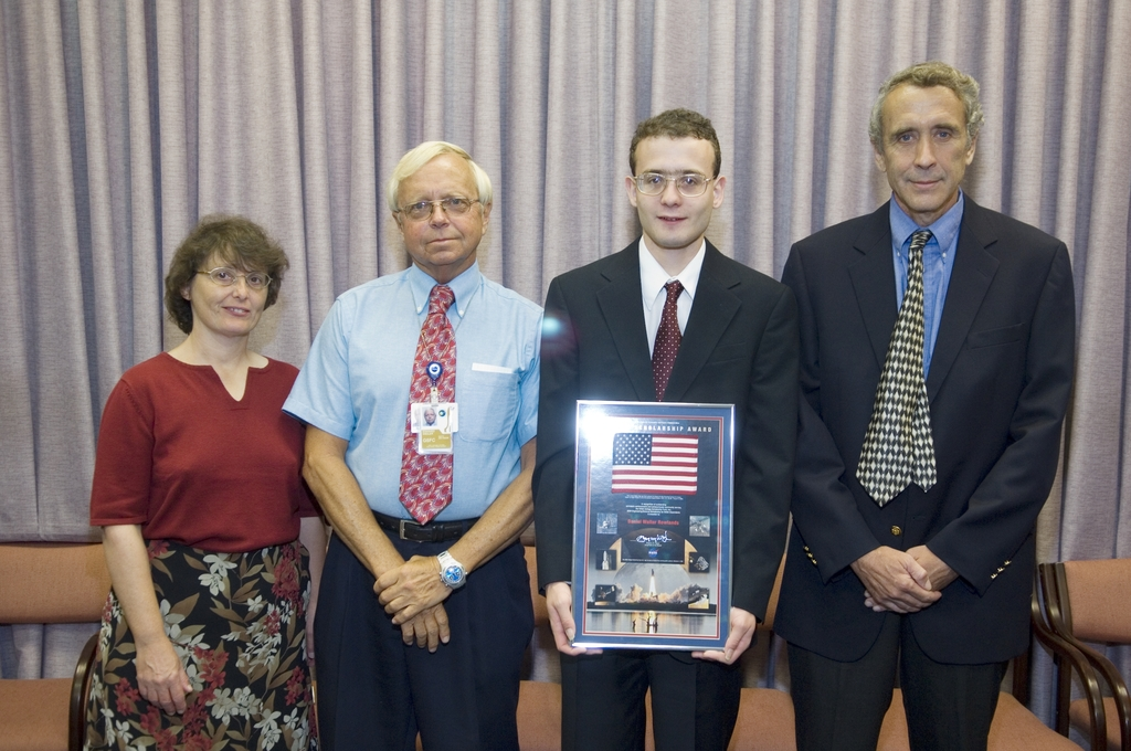 DR. ED WEILER PRESNTING A NASA  SCHOLARSHIP AWARD