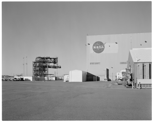 Establishing view, looking north, of NASA DFRC Mate-Demate Device (MDD) and Shuttle Hangar (Building 4833) in foreground, right.