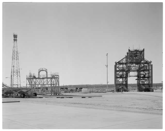 Establishing view, looking west, of NASA DFRC Mate-Demate Device (MDD), RF tower, and Orbiter Aft Access Platform (1201 Stand) on left