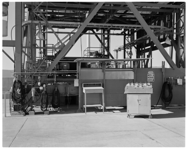 Main Hoist Control Operator Station of NASA DFRC Mate-Demate Device (MDD) on right. 110 volt power cords and #2 main hoist (obscured, behind) on left.