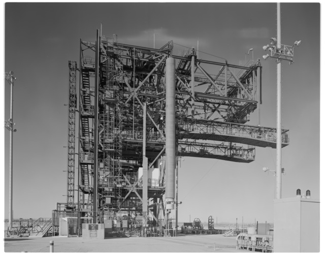 NASA DFRC Mate-Demate Device (MDD) full side view looking north, showing South Personnel/Equipment hoist and port side Shuttle Access Platform (SAP) and counter-balance