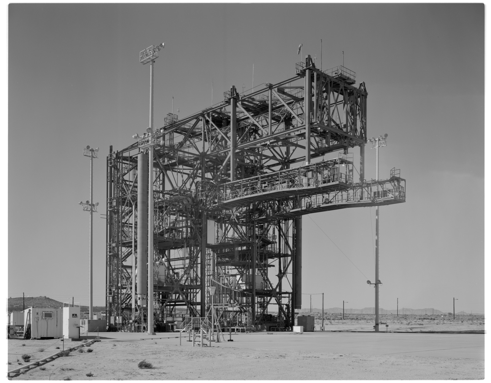 NASA DFRC Mate-Demate Device (MDD) full side view looking northwest, showing both Shuttle Access Platforms (SAPs) and counterbalances