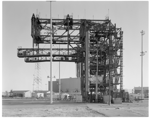 NASA DFRC Mate-Demate Device (MDD) full side view looking south, showing North Personnel/Equipment hoist and starboard side Shuttle Access Platform (SAP) and counter-balance