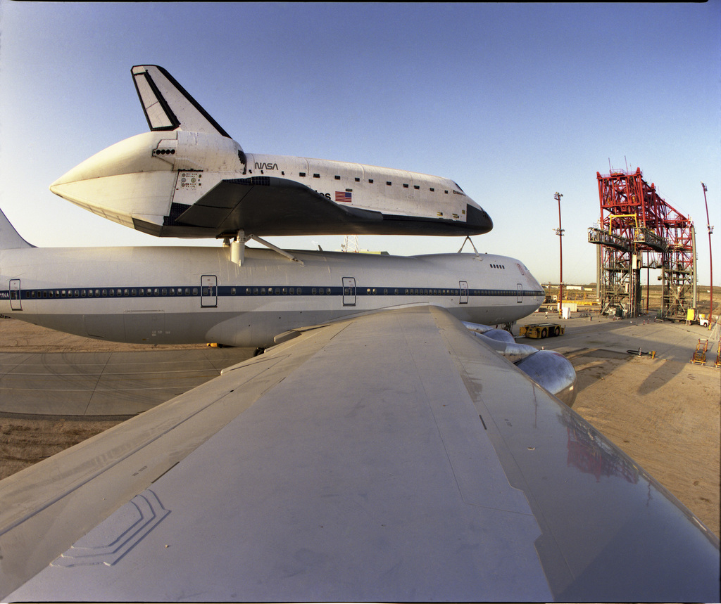 Shuttle Endeavour and 747 SCA after being mated, backed out of Mate-Demate Device (MDD), photo from right wing of 747