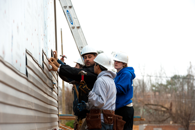 Tornado - Pratt City, Ala. , Jan. 17, 2012 -- Habitat for Humanity is building 2 new homes for tornado survivors. Jewish and Muslim NYU student and staff volunteer at the job site working side-by-side. FEMA funding and coordination with volunteer agencies help make cooperation like this possible.  FEMA photo/Tim Burkitt