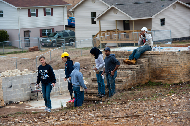 Tornado - Pratt City, Ala. , Jan. 17, 2012 -- Jewish and Muslim NYU student volunteers take a short break at a job site where 2 new homes are being built for tornado survivors. FEMA funding and coordination with volunteer agencies helped make this happen.  FEMA photo/Tim Burkitt