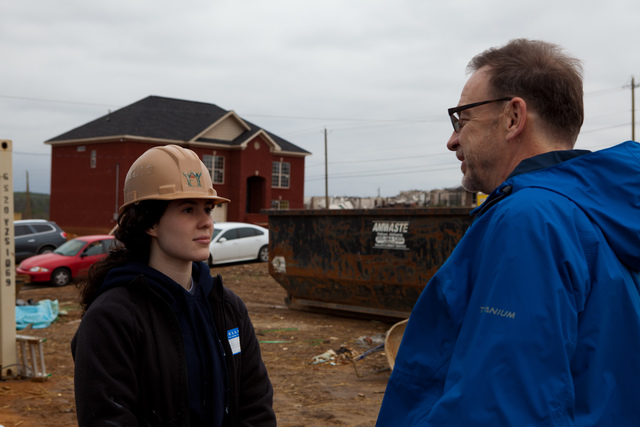 Tornado - Pratt City, Ala. , Jan. 17, 2012 -- Nearly nine months after the deadly tornadoes struck the Southeast, rebuilding is still occurring.  David Myers, director of the DHS Center for Faith-based and Neighborhood Partnerships talks with an NYU student volunteer. Jewish and Muslim NYU students are  volunteering at a job site where 2 new homes are being built. FEMA funding and coordination with volunteer agencies helped make this happen.  FEMA photo/Tim Burkitt