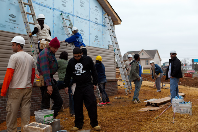 Tornado - Pratt City, Ala. , Jan. 17, 2012 -- Nearly nine months after the deadly tornadoes struck the Southeast, rebuilding is still occurring. Habitat for Humanity and Jewish and Muslim NYU student volunteers at a job site where 2 new homes are being built. FEMA funding and coordination with volunteer agencies helped make this happen.  FEMA photo/Tim Burkitt