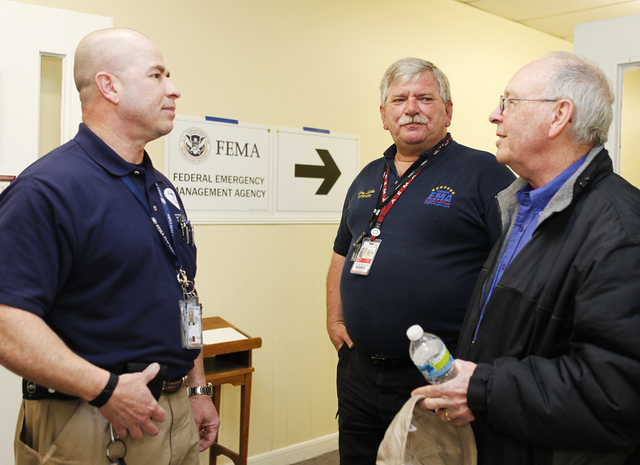 Flooding ^ Severe Storm ^ Tornado - Center Point, Ala. , Feb. 3, 2012 -- FEMA Federal Coordinating Officer (FCO) Joe Girot, speaks with Center Point Mayor Tom Henderson (r) and Alabama Emergency Management Regional Coordinator Ricky Little (c) about the recovery efforts in Center Point.  FEMA is supporting the recovery from the severe storms, tornadoes, straight-line winds, and flooding that damaged or destroyed parts of Alabama during the period of January 22-23, 2012.  FEMA/ David Fine