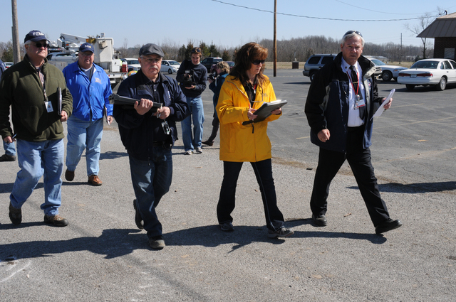 Severe Storm ^ Tornado - Harrisburg, Ill. , March 5, 2012 -- As local media films the event, this Individual Assistance Preliminary Damage Assessment Team (IA PAD) (Larry Duke, FEMA IA; Ed Williams, SBA; Feliz Lopez, FEMA IA; Kate Mackz, State EMA Field Specialist, and Bill Summers, local Fire Chief) begins the walk to closely inspect areas damaged by the February tornado. The IA PDA is an important part of the State request for federal disaster assistance.  George Armstrong/FEMA