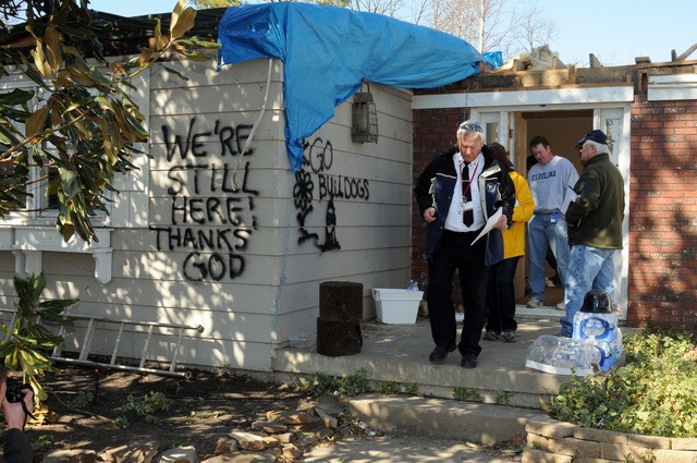 Severe Storm ^ Tornado - Harrisburg, Ill. , March 5, 2012 -- As result of the February tornado, Individual Assistance Preliminary Damage Assessments are being conducted door to door in storm affected areas of Saline County by  local, state, and federal teams as represented here by Harrisburg Fire Chief Bill Summers, Kate Mackz, State Emergency Management Agency Representative, and Larry Duke, FEMA Individual Assistance Specialist. This Assessment is required before FEMA can recommend issuance of a Presidential Disaster Declaration.  George Armstrong/FEMA