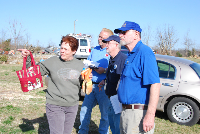 Severe Storm ^ Tornado - Henryville, Ind. , March 6, 2012 -- Whenever possible, members of the team doing preliminary damage assessments in Henryville talk with residents and homeowners. The team in the hard-hit community, one of several hit by EF-3 and EF-4 tornadoes March 2, included Jeff Gabbard, left center, state fire marshal's building code inspector, Patrick Fisher, right center, FEMA, and Roger Crump, right, U. S. Small Business Administration construction analyst.  Michael Raphael/FEMA photo