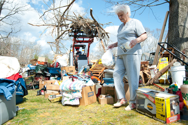 Tornado - West Liberty, Ky. , March 14, 2012 -- Survivor Anna L Roller sorts through her belongings while volunteers with Mennonite Disaster Services use chainsaws and end loaders to clean up storm debris.  FEMA helps coordinate with volunteer organizations to ensure help gets to the areas that need it most. Photo by Tim Burkitt/FEMA