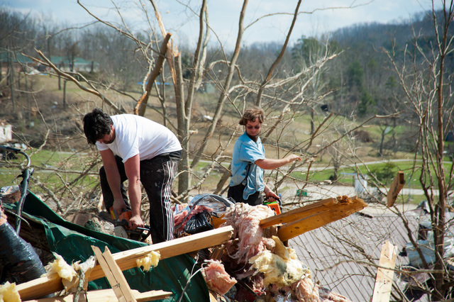 Tornado - West Liberty, Ky. , March 14, 2012 -- Volunteers with Mennonite Disaster Services use chainsaws and end loaders to clean up storm debris.  FEMA helps coordinate with volunteer organizations to ensure help gets to the areas that need it most.  Photo by Tim Burkitt/FEMA