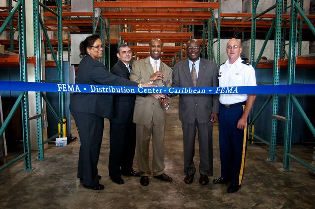 Caguas, Puerto Rico, May 31, 2012 -- Lynn Canton, FEMA Region II Administrator, Alejandro De La Campa, Caribbean Area Division Director, Eric Smith, Assistant Administrator for Logistics Management, Brigadier General Elton Lewis, Virgin Islands Territorial Emergency Management Agency Director and COL Daryl D. Jaschen cut the ribbon of the new Distribution Center in Puerto Rico. Eluid Echevarria/FEMA