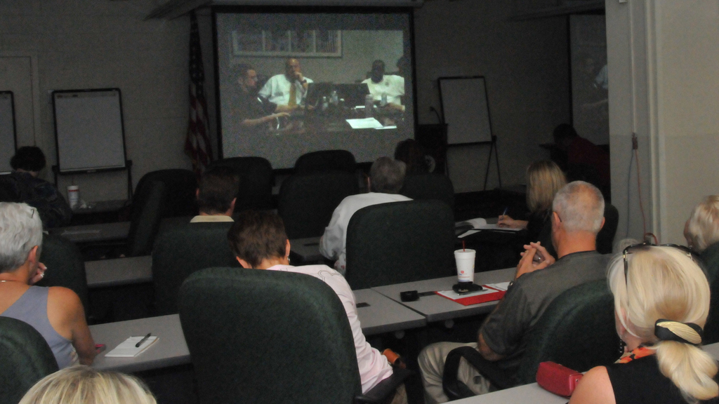 Denton, Texas, June 12, 2012 -- Staff from FEMA Region 6 watch the FEMA Qualifications System video-teleconference in the Jade Room at FEMA Region 6. FEMA/Earl Armstrong