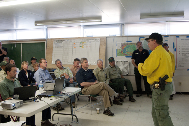 Fire - Fort Collins, Colo. , June 16, 2012 -- Larimer Sheriff Justin Smith briefs Sen. Michael Bennet (2nd row, left), Sen. Mark Udall (2nd row, center), Governor John Hickenlooper (2nd row, right), and FEMA RA Robin Finegan (3rd row, left) at the High Park Fire Incident Command Post in Fort Collins on Sat. , June 16, 2012 FEMA Photo/Cynthia Hunter