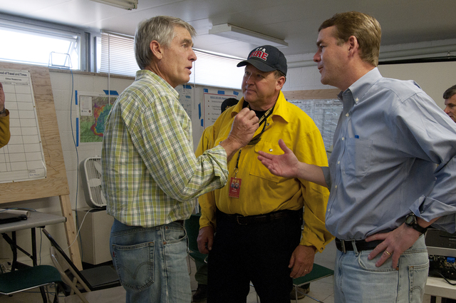 Fire - Fort Collins, Colo. , June 16, 2012 -- Senators Mark Udall (left) and Michael Bennet (right) have a discussion with Poudre Fire Authority Chief Tom DeMint after a High Park Fire briefing on Sat. , June 16, 2012.
