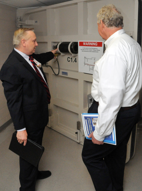 """Emergency Planning and Security ^ Flooding - Houston, Texas, June 28, 2012 -- Bert Gumeringer, Dir. of Facilities/Operations and Security at Texas Children's Hospital, show FEMA Dep. Administrator Rich Serino the operations of a """"submarine door. """" The door is one of many designed to halt flooding in the tunnel system under the Texas Medical Center. FEMA/Earl Armstrong"""