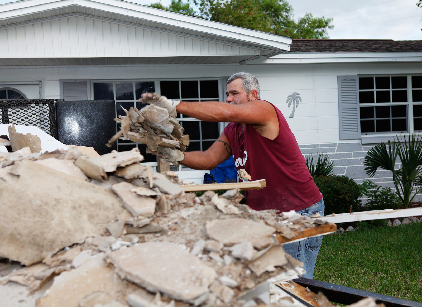 Flooding ^ Hurricane/Tropical Storm - Trinity, Fla. , June 30, 2012 -- Pasco County, Florida homeowner disposes damaged Sheetrock and household belongings after flooding from Tropical Storm Debby dumped more than 20 inches of rain in the area.  FEMA/David Fine
