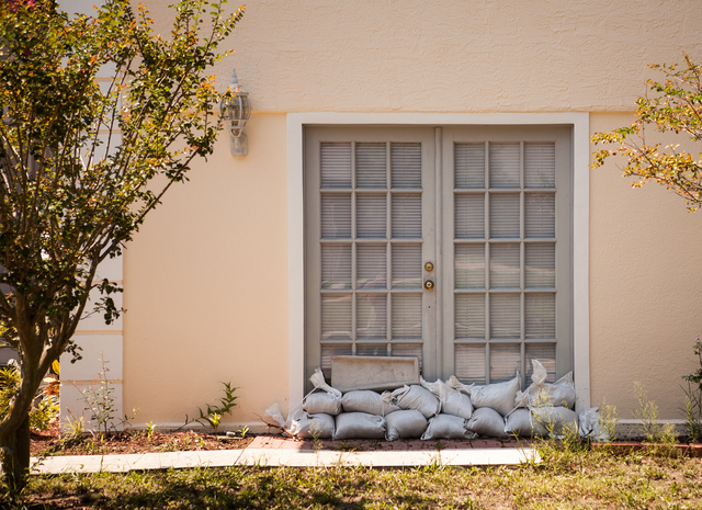 Flooding ^ Hurricane/Tropical Storm - Trinity, Fla. , June 30, 2012 -- Sand bags placed in front of doors during the heavy rains of Tropical Storm Debby are used to prevent flooding inside homes in Pasco County Florida.  FEMA/David Fine