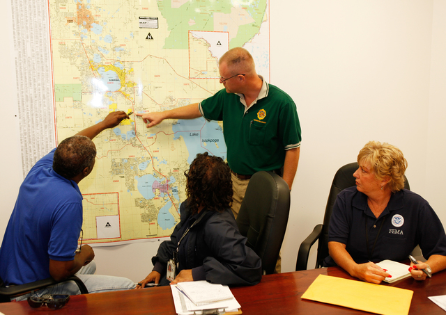 Flooding ^ Hurricane/Tropical Storm - Sebring, Fla. , July 2, 2012 -- Emergency Management Director Scott Canaday identifies areas of Highlands County for SBA James Gray (L), Cheryl Catchings and Renee Bafalis(r) of FEMA that were damaged by heavy rains and tornado touch downs from Tropical Storm Debby.  FEMA/David Fine