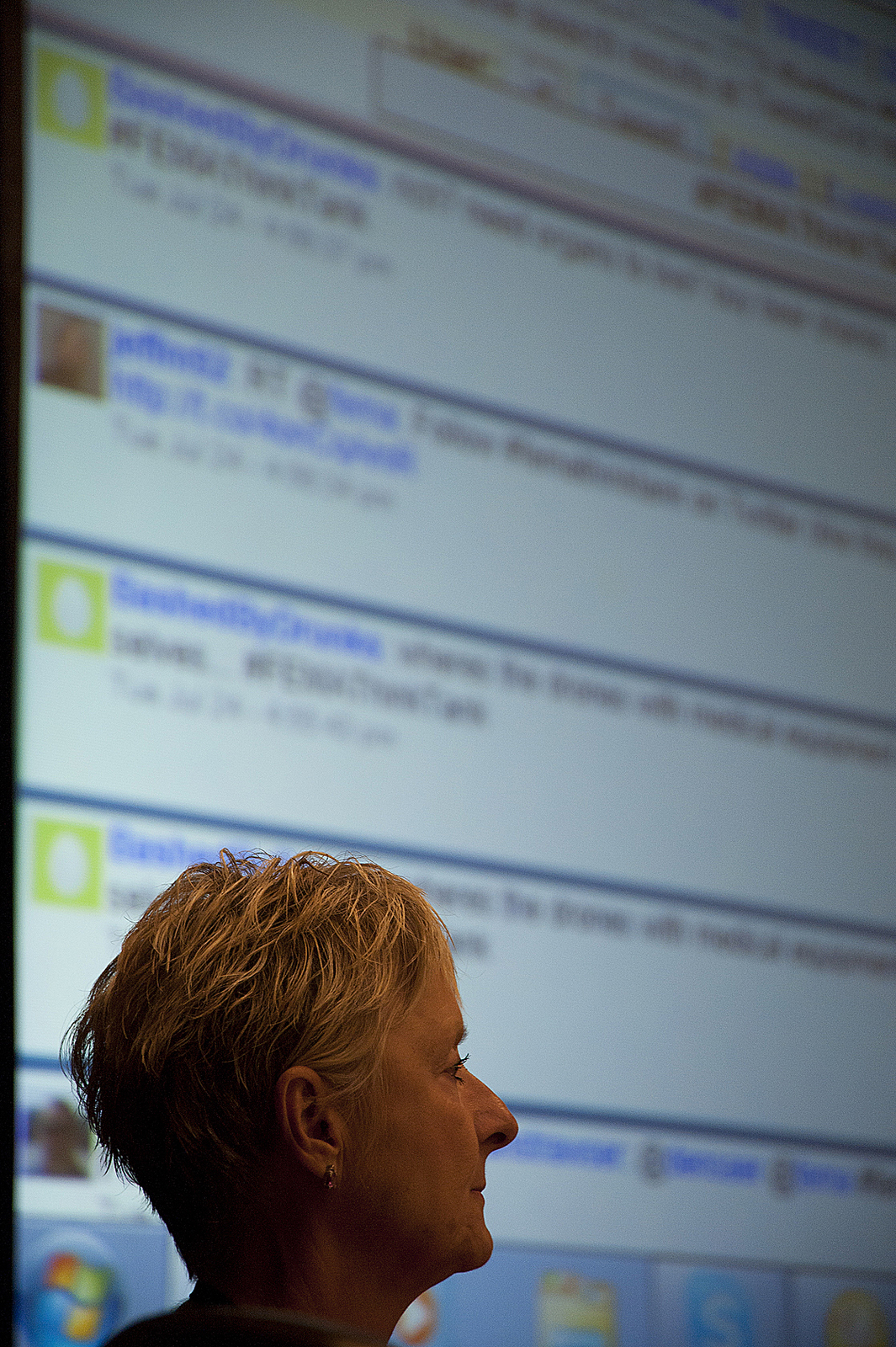 Emergency Planning and Security - Colorado Springs, Colo. , July 24, 2012 -- A FEMA Think Tank participant watches discussion with the national streaming Twitter feed in background. The Think Tank was held Tue. , July 24 in Colorado Springs during the two-day Building Resilience through Public-Private Partnerships Conference.