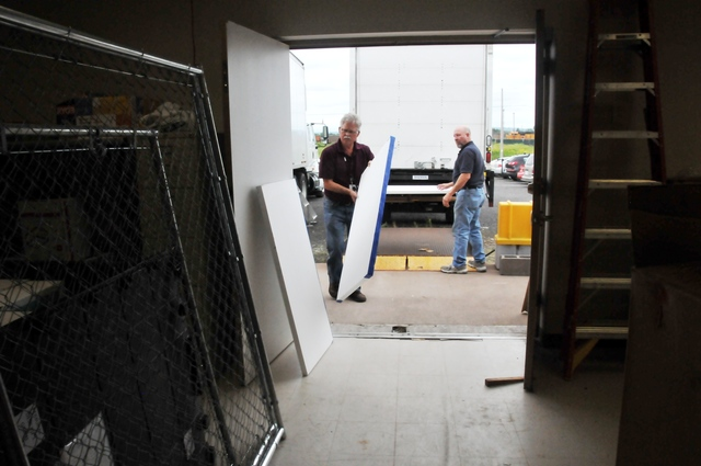 Flooding ^ Severe Storm - Superior, Wis. , Aug. 9, 2012 -- Robert Schultz (left) and Robin Kunst, logistics specialists for the Federal Emergency Management Agency, prepare temporary office dividers for use at the Wisconsin Joint Field Office here. FEMA is working with state and local officials to help repair damage to infrastructure in the aftermath of severe storms and flooding in June. Norman Lenburg/FEMA