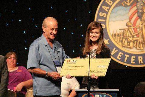 Emergency Planning and Security - Aug. 22, 2012 -- Donald L. Samuels, national commander of the Disabled American Veterans, presents Christiana Hess with a check for the first-place scholarship of $20,000 (funded by Ford Motor Company).