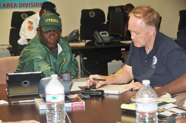 Hurricane/Tropical Storm - Saint Croix, US Virgin Islands, Aug. 23, 2012 -- General Elton Lews (left), Director of the Virgin Islands Territorial Emergency Management Agency (VITEMA), and Terry Winters, FEMA Operations Division Supervisor for St. Croix, lead a conference call of the Emergency Management Council (EMC) during the response to Tropical Storm Isaac.