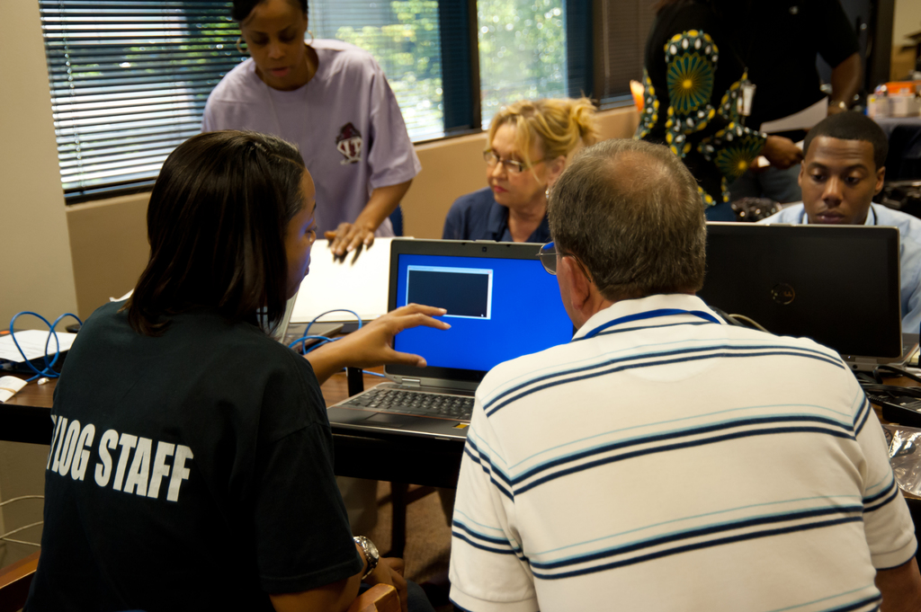 Hurricane/Tropical Storm - Atlanta, Ga. , Aug. 26, 2012 -- FEMA Community Relations Specialists (CR) receive computers and other equipment from logistics staff before deploying for Tropical Storm Isaac. Community Relations' role includes outreach and information sharing with private sector stakeholders, intergovernmental stakeholders, voluntary agencies, and faith-based and community groups. FEMA/Tim Burkitt