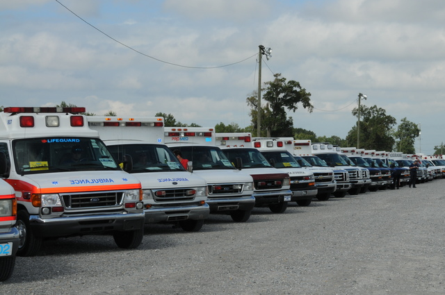 Baton Rouge, La. , Aug. 28, 2012 --  Scores of ambulances staged in Baton Rouge await orders to deploy to help Louisiana residents as Hurricane Isaac threatens to make landfall along the Gulf Coast. The State of Louisiana, FEMA, and other federal agencies are working closely, ready to respond where needed. Gina Cortez/FEMA